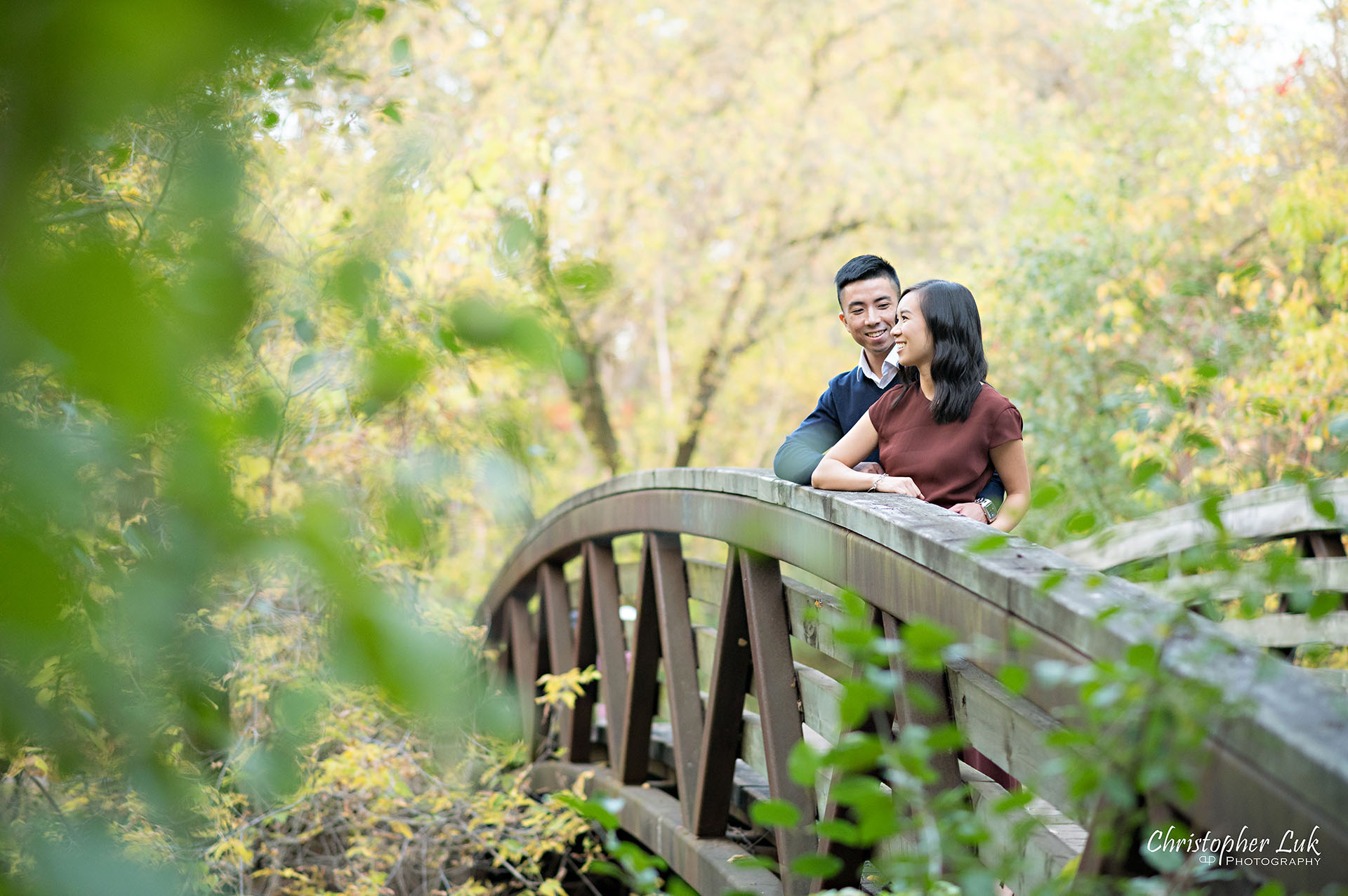 Christopher Luk Toronto Wedding Engagement Session Photographer Autumn Fall Leaves Natural Candid Photojournalistic Bride Groom Bridge Hug Hold Detail