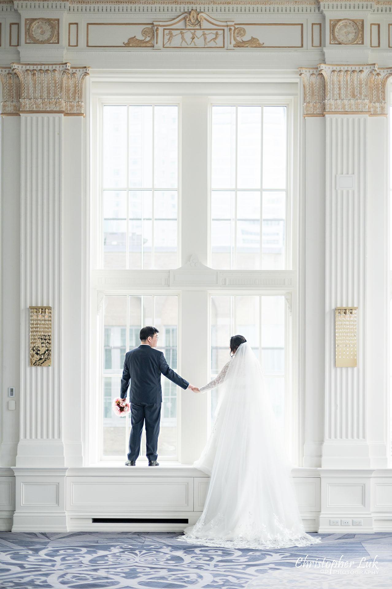 King Edward Hotel Crystal Ballroom Toronto Wedding Photographer MicroWedding Bride Groom Window Frame Long Train Bridal Dress Gown Cathedral Veil Holding Hands